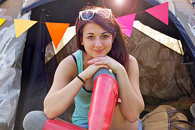Teenage Girl Sitting Outside Tent - p669m806292 by Jutta Klee photography
