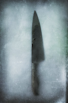 Knife frozen in ice - p1228m1193814 by Benjamin Harte