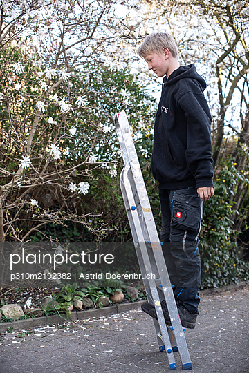 Boy on a ladder - p310m2192382 by Astrid Doerenbruch