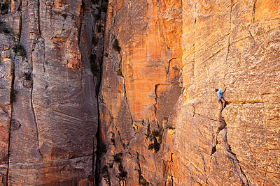 Full length of man climbing mountain - p1166m1406817 by Cavan Images