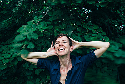 Carefree Woman Laughing - p1262m1087734 by Maryanne Gobble