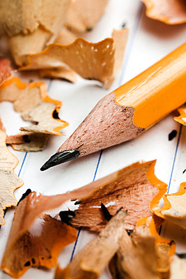 A pencil and pencil shavings atop lined notebook paper, extreme close up - p301m799683f by Epoxydude