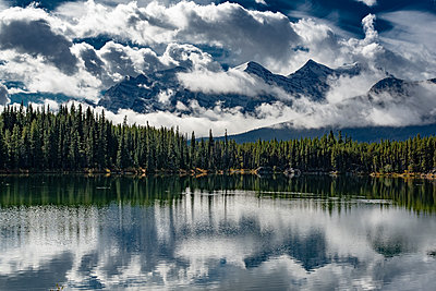 Dramatic clouds at Herbert Lake in Canada - p1455m2092368 by Ingmar Wein