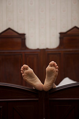 Female feet in bed - p502m1039836 by Tomas Adel