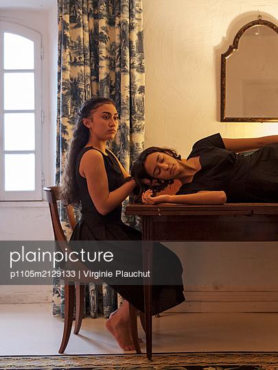 Two women in black dresses - p1105m2129133 by Virginie Plauchut