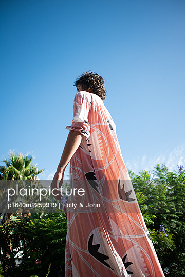 Woman in colourful dress - p1640m2259919 by Holly & John