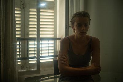 Sad young woman - p1321m2027532 by Gordon Spooner