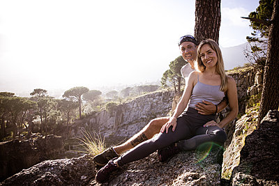 Young couple takes a break in mountain landscape - p1640m2260957 by Holly & John