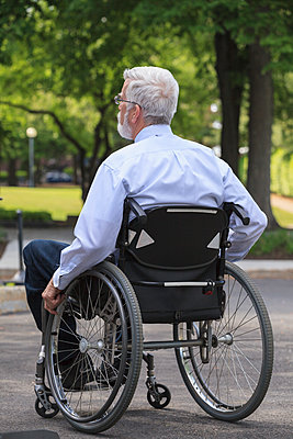 Caucasian businessman in wheelchair outdoors - p555m1306291 by Disability Images