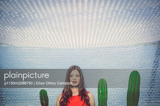 young woman in cactus garden 2 - p1150m2288750 by Elise Ortiou Campion