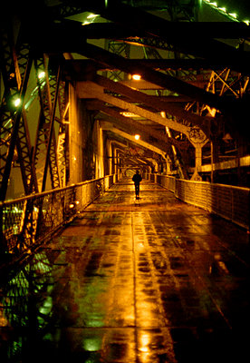 Pedestrian bridge at night - p1270m1106002 by Clayton Burkhart
