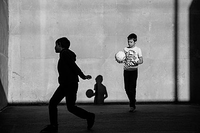 Shadows and Children Playing Ball - p1262m1064003 by Maryanne Gobble