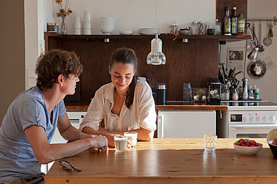 Young couple sitting at dining table - p301m1102143f by Halfdark