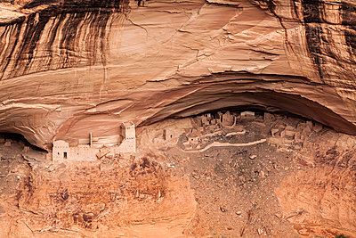 Ancient ruins below rock formation at Canyon de Chelly - p1094m1209094 by Patrick Strattner