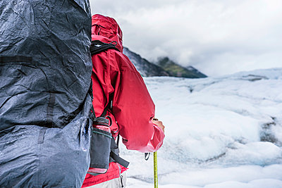 Male hiker on Root Glacier Wrangell St. Elias National Park and Preserve near McCarthy, Alaska - p343m1475638 by Cavan Images