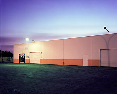 Floodlights over industrial garage doors - p555m1311525 by Tom Paiva Photography