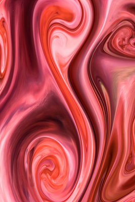 Overhead macro shot of colorful abstract pattern of colors, milk and dishwashing liquid - p1166m2024904 by Cavan Images