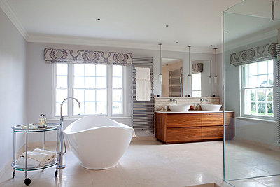 Freestanding bath and double was basin in Suffolk home - p3493603 by Robert Sanderson