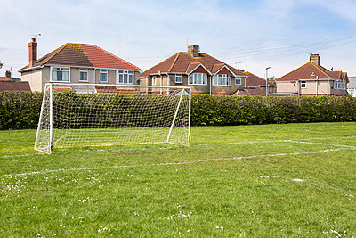 Housing estate and football field I - p1057m903770 by Stephen Shepherd