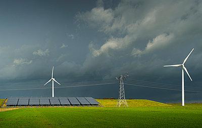 Wind turbine and solar panels on former waste dump, Waalwijk, Noord-brabant, Netherland - p429m1022527 by Mischa Keijser
