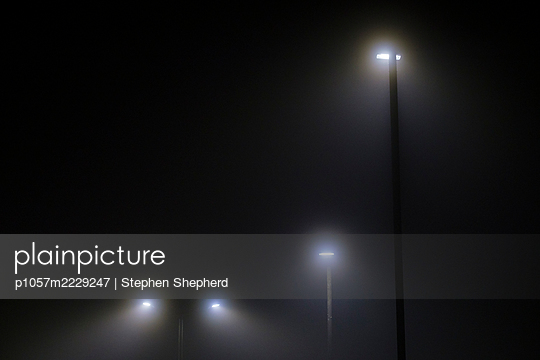 Street lights in the thick fog - p1057m2229247 by Stephen Shepherd