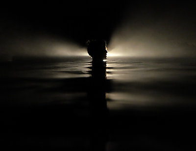 Boy in Dark Water - p1503m2015864 by Deb Schwedhelm