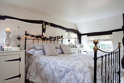 Timber framed bedroom in Sussex home  UK - p3493519 by Robert Sanderson