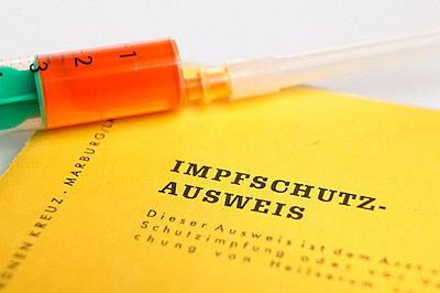 Syringe and inoculation pass - p3001157f by Tom Hoenig