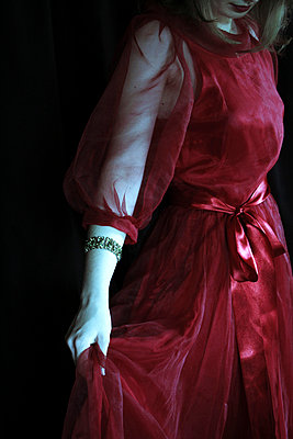 woman in a red dress - p4760356 by Ilona Wellmann