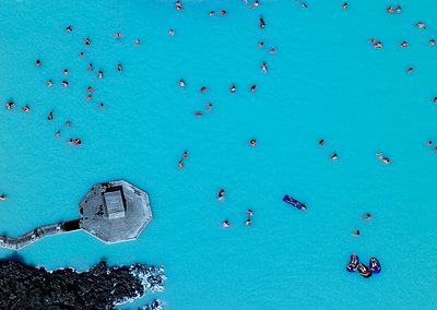 Aerial view of geothermal pool in Iceland - p1166m2201839 by Cavan Images