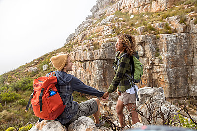Young couple mountain hiking - p1355m1574157 by Tomasrodriguez
