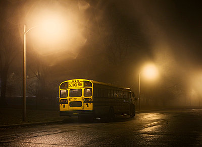 Schoolbus at night, illuminated - p3720431 by James Godman
