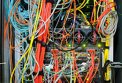 Close up of wires on server - p429m665277f by Mischa Keijser