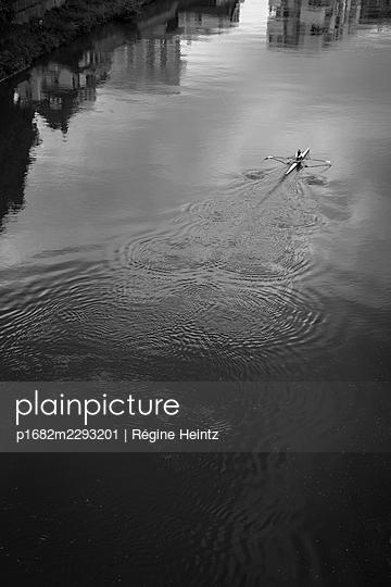 Man rowing on the Danube in Ulm (Germany) - p1682m2293201 by Régine Heintz