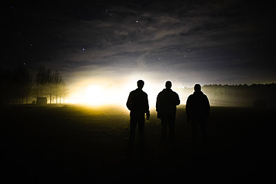 Three Men at dusk - p1424m1501234 by Blake Burton
