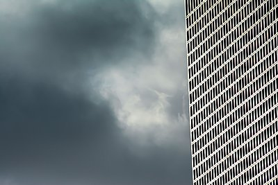 Skyscraper windows and Cloudy Sky - p1072m957331 by Tal Paz-Fridman
