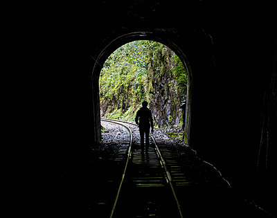 Hiker on train tracks that lead up to Aguas Calientes - the starting point for excursions to Machu Picchu, Peru - p429m1494654 by Henn Photography