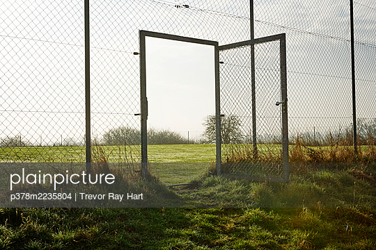 Open gate to field - p378m2235804 by Trevor Ray Hart