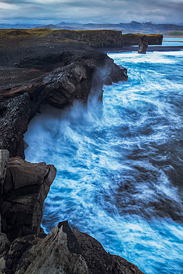 Large waves splash against the cliff sides of Dryholaey, Southern Iceland; Iceland - p442m1482848 by Robert Postma
