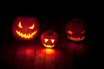 Three Halloween pumpkins - p312m992858f by Malcolm Hanes