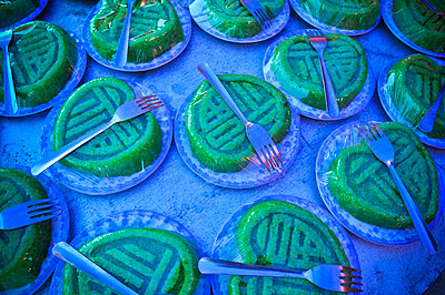 Wrapped green cakes set up with forks for a wedding party in Khanh Hoa - p934m1093727f by Thiery Beyne