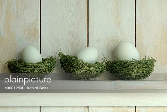 Easter eggs lying on shelf on grass
