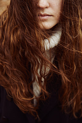Woman with long hair and curls  - p1540m2175080 by Marie Tercafs