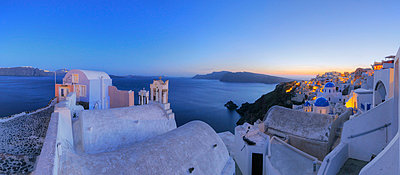 View of Oia village with bell tower of Greek Orthodox Church at Santorini - p300m731253f by Martin Rügner