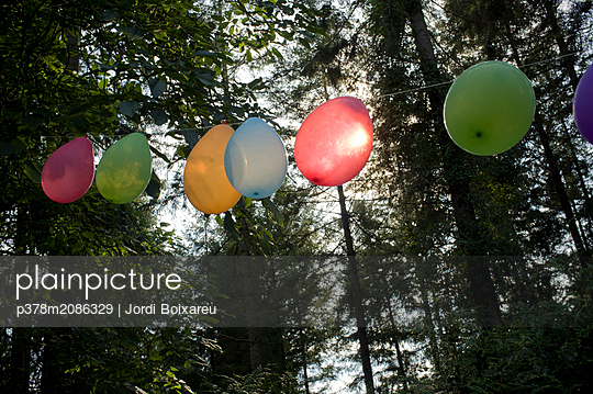 Ballons in the forest - p378m2086329 by Jordi Boixareu