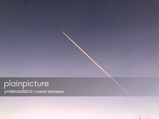Starting airplane, vapour trail - p1590m2230312 by marion blomeyer