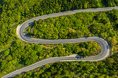 Aerial view of drone to road through mountain with bends - p1596m2184499 by Nikola Spasov