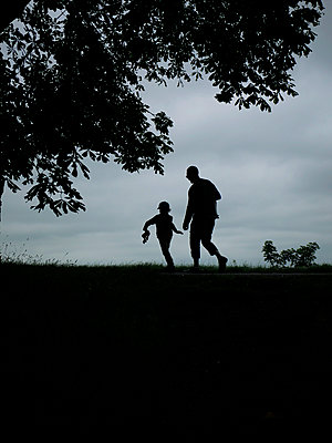 A man and a young boy walking - p1028m2289441 by Jean Marmeisse