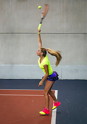 Young woman playing tennis in an indoor tennis center - p300m1059088f by Marco Govel