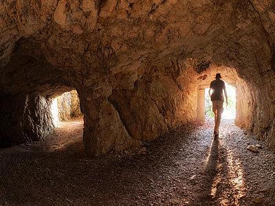Italy, Veneto, Strada delle 52 Gallerie, hiker in a tunnel - p300m2023629 by Albrecht Weißer